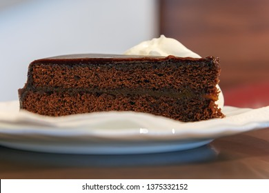 Brown cake on plate.