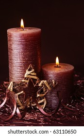 Brown candle on dark background