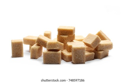 Brown cane sugar cubes isolated on white background