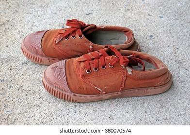 Brown canvas students shoes on concrete floor
