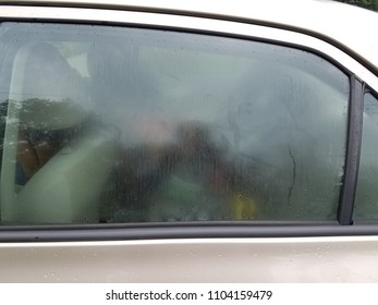 brown car with foggy window