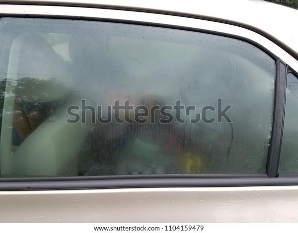 brown car with foggy window