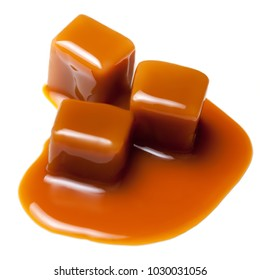 Brown Caramel candies  isolated on white background.  Butterscotch toffee sauce. Pieces of caramel candy, macro