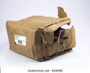 Brown cardboard box destroyed in shipping
