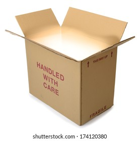 A brown cardboard box open with light coming from out the box and isolated on a white background