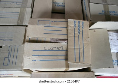 brown cardboard packing boxes in storage outside gathering dust