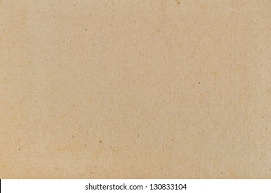brown cardboard texture closeup, natural rough textured paper background