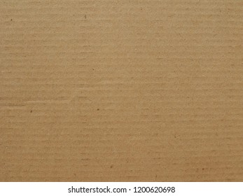 Brown cardboard texture useful as a background, soft pastel colour