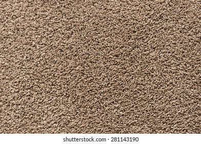 brown carpet with long fringes background