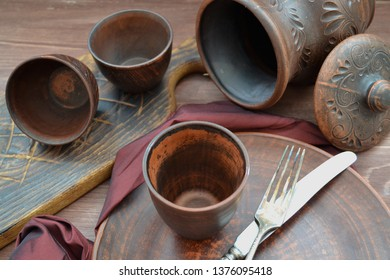 Brown  ceramic dishware and wooden objets in russian style