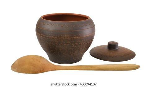 brown ceramic pot and wooden spoon isolated on a white background