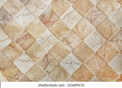 it is brown ceramic tile texture for pattern and background.