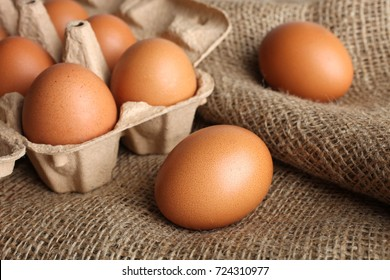 Brown chicken eggs in a box for eggs on the background of burlap.