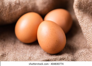 brown chicken eggs closeup on a vintage background
