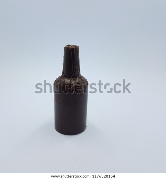 brown chocolate bottle candy on white background