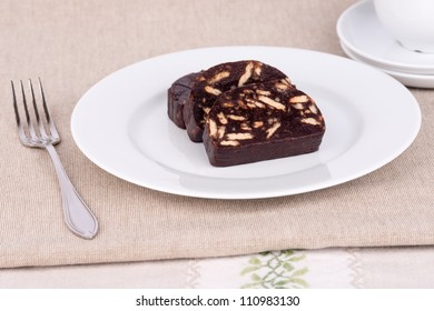 Brown chocolate cake with biscuits and sugar.