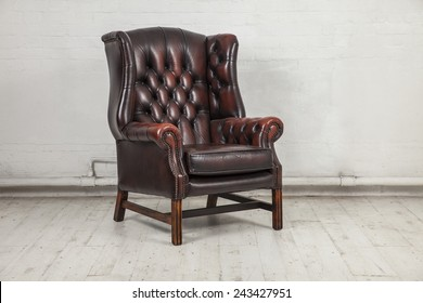 brown classic chair in dusty warehouse space
