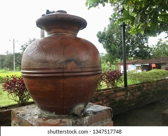 Brown clay barrel (gentong) on bricks. It is used for a ceremonial ablution (wudhu) before praying (sholat).