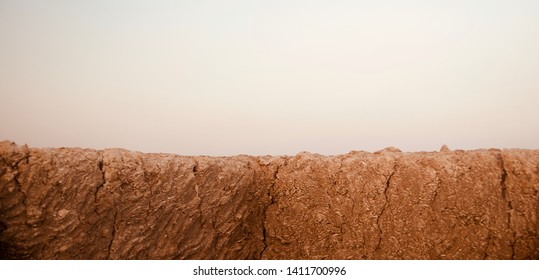 A brown clay made parts of a protection wall isolated unique photo