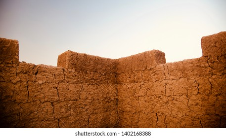 A brown clay made structure of a house isolated unique photo