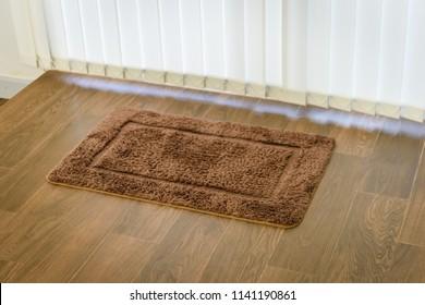 Brown cleaning door mat on the floor.(carpet)
