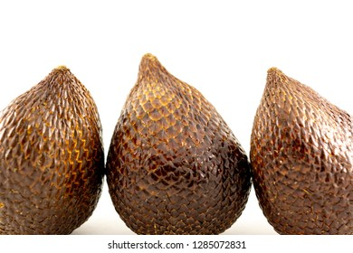brown close up salak fruit isolated white background