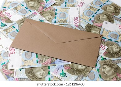 Brown closedenvelope on 500 PLN banknotes background