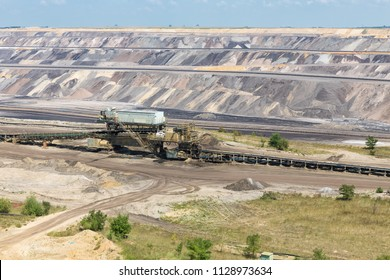 Brown coal open pit landscape with conveyer belt in Garzweiler mine Germany