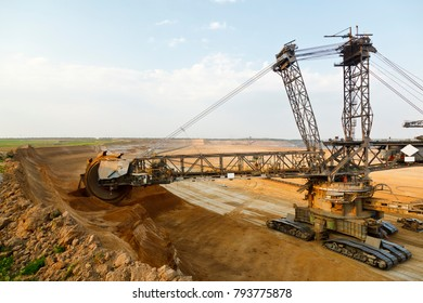 A brown coal pit mine with a giant bucket-wheel excavator, one of the worlds largest moving land vehicles.