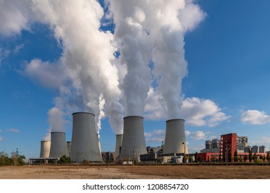 Brown coal power plant in front of a blue sky