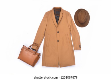 brown coat with leather bag, hat on white background