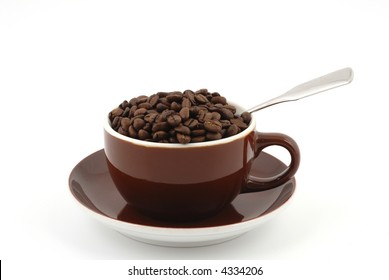 Brown coffee beans in a brown coffee cup in front of a white background