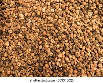 brown coffee beans dried prepare to roast as picture backdrop or background.