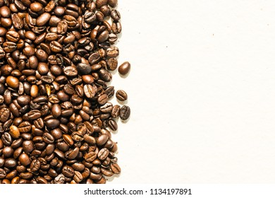 Brown coffee beans textures and surface for background and copy space for tex