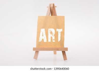 Brown color  notepaper on a painting tripod on white background