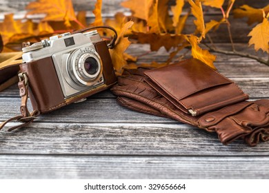Brown colored leather set of retro camera, gloves and wallet