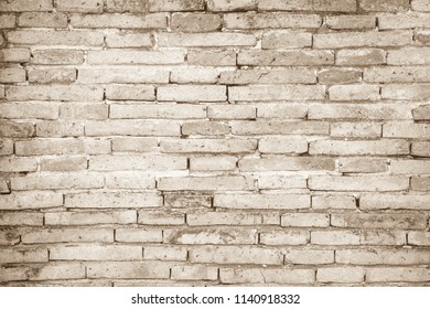Brown colors and white brick wall art concrete or stone texture background in wallpaper limestone abstract paint to flooring and homework/Brickwork or stonework clean grid uneven interior rock old.