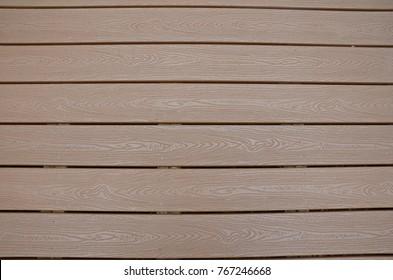 brown composite wood floor on a deck