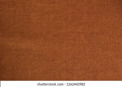 Brown corduroy fabric. Close-up. Background
