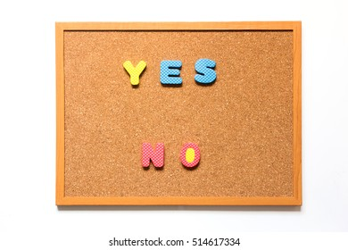 Brown cork board with wording yes no on white background