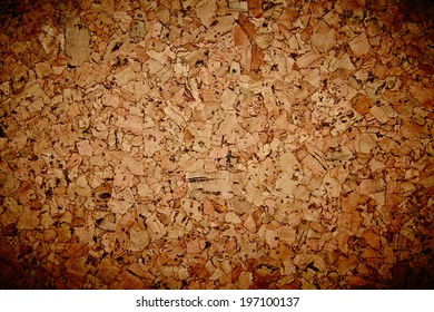 Brown cork mat as abstract texture background composition, top view above. Grungy background