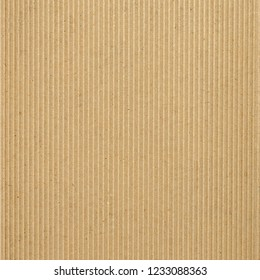 Brown corrugated cardboard sheet useful as a background, soft pastel colour