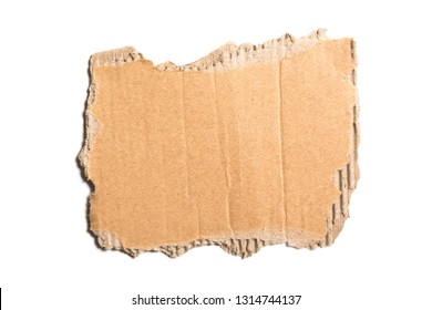 Brown corrugated cardboard torn piece isolated on white background