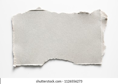 Brown corrugated texture paper torn on white background. rip of cardboard sheet used as a background .
