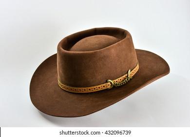Brown cowboy hat on white background.Vintage American western style felt hat . df5c33984d0d