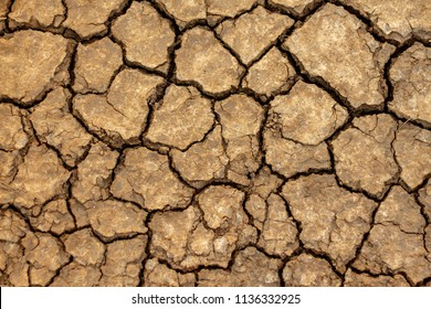 Brown Cracked ground,Cray Soil,Mud Crack.Cracks on the surface of the earth are altered by the shrinkage of mud due to drought conditions of the terrain.