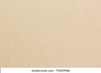 Brown craft cardboard paper sheet of recycle paper background and texture.
