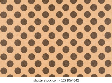 Brown craft paper with a black polka dot pattern