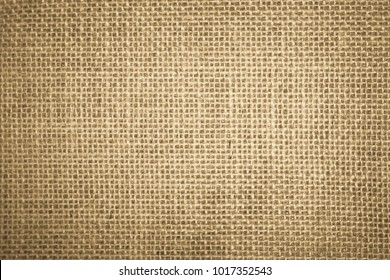 Brown and Cream Canvas or rustic jute sackcloth woven fabric texture background. Textiles for coffee beans.