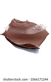 Brown creamy cosmetic sample isolated on white